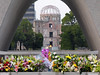"""The Flame of Peace, here visible against the Dome, has burned continuously since it was lit on August 1, 1964. It symbolizes the anti-nuclear resolve to burn the flame """"until the day when all such weapons shall have disappeared from the earth."""""""