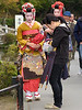 Two Geisha (artistic entertainers, not prostitutes as sometimes mistakenly believed) or possibly Maiko, apprentice geisha