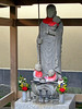 Parents often place bibs, hats or toys on the statues of Jizo, either to aid their prayers, or in thanks for helping to cure a sick child