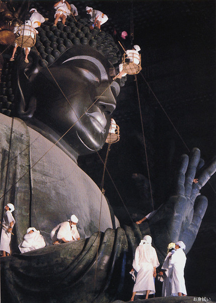 This image of the statue being cleaned puts its size into perspective! <i>[From a tourist booklet]</i>