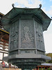 The bronze Octagonal Lantern dates from the original 8th-century temple. Pindola's statue can just be seen bottom left