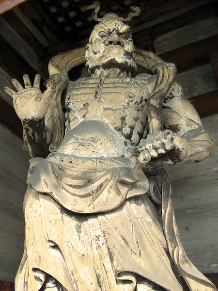 "Two eleven foot tall Kongo Rikishi guardian figures stand either side of the Sanmon (Gate). This left-hand one, called Misshaku Kongō, has his mouth closed, sounding the syllable ""hum"""