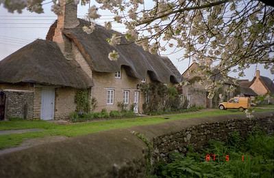 Another pleasant view of an interesting thatched roofed cottage.
