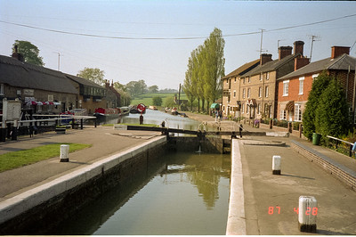 One of the locks on a canal to allow for the differences in water levels due to differences in the land elevations.  Sometimes there is an authorized 'lock tenderer', sometimes the boaters themselves to operate the locks.