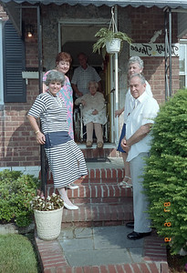 A family group photo in the front entrance to Mom and Mary's house.  Martha, Mary, Mom & Joe in doorway, Dolly and Norman.