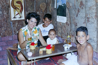 Martha and family waiting for lunch in a tiny restaurant in Hajiochi, Japan. '65-'66.