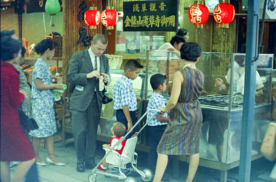 Gib Hattery, Fairchild engineer with Mom and boys buying a snack at a sidewalk kiosk, Tokyo. '65-'66.