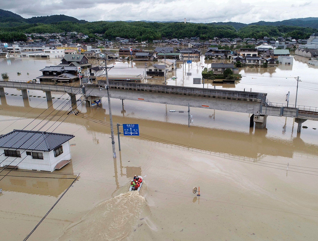 . Houses are partly submerged houses in water from heavy rains, in Kurashiki, Okayama prefecture, southwestern Japan, Sunday, July 8, 2018. Heavy rainfall hammered southern Japan for the third day, prompting new disaster warnings on Kyushu and Shikoku islands Sunday. (Koji Harada/Kyodo News via AP)