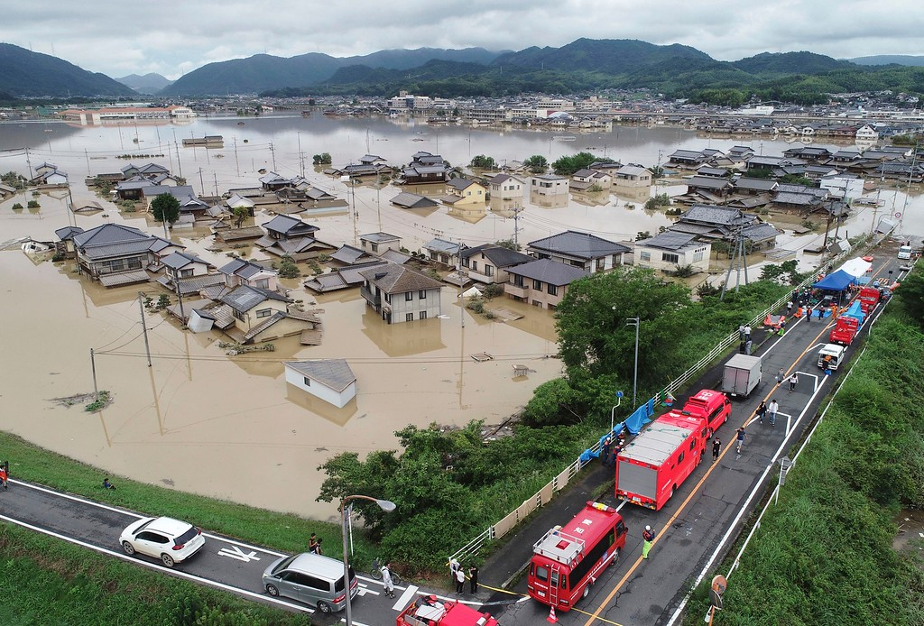 . Houses are flooded, following heavy rain in Kurashiki city, Okayama prefecture, southwestern Japan, Sunday, July 8, 2018. Heavy rainfall hammered southern Japan for the third day, prompting new disaster warnings on Kyushu and Shikoku islands Sunday. (Koji Harada/Kyodo News via AP)