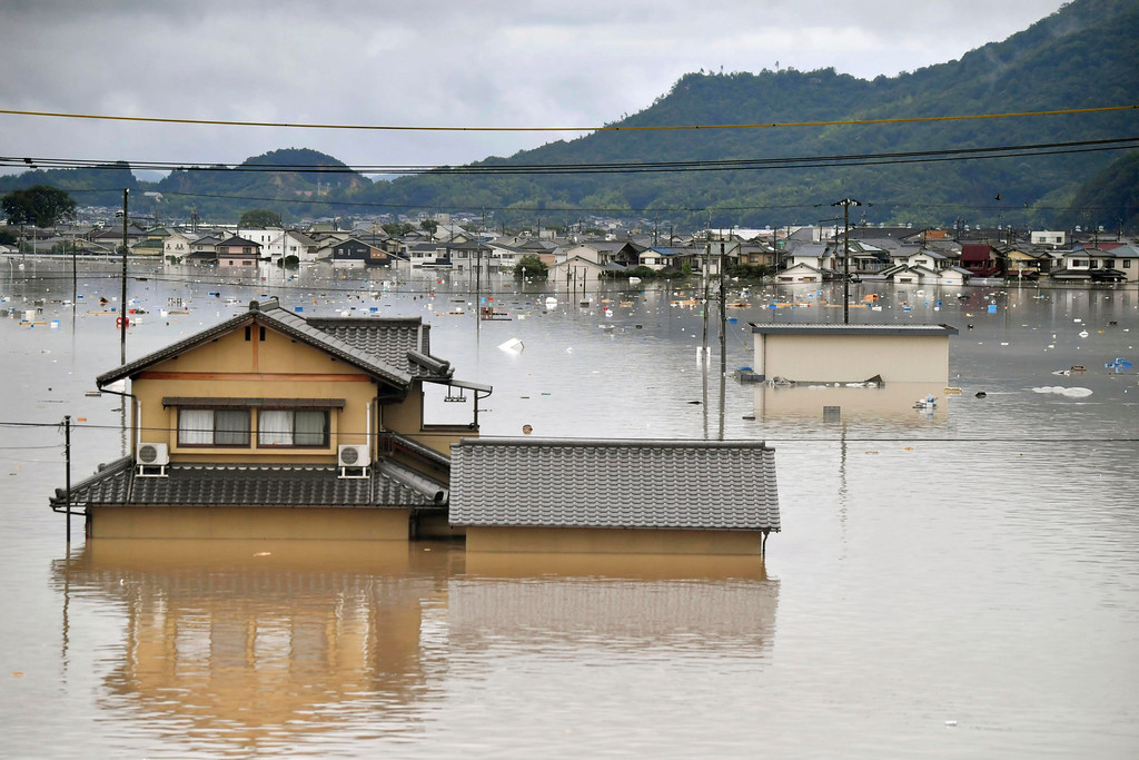 . Residential buildings are partially submerged in floodwaters caused by heavy rains in Kurashiki, Okayama prefecture, southwestern Japan, Saturday, July 7, 2018. Torrents of rainfall and flooding continued to batter southwestern Japan. (Koki Sengoku/Kyodo News via AP)