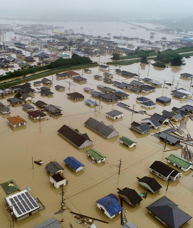 . Residential areas are flooded in Kurashiki, Okayama prefecture, western Japan Saturday, July 7, 2018. Torrents of rainfall and flooding battered a widespread area in southwestern Japan on Saturday, with local media casualty reports climbing quickly. (Kyodo News via AP)