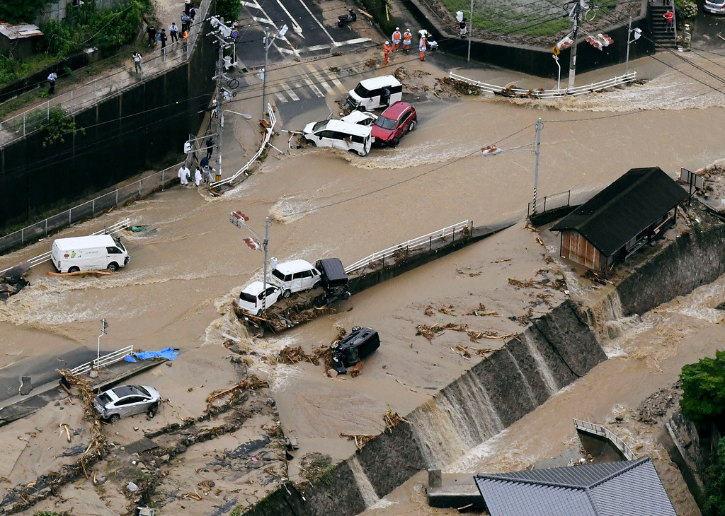. Roads are covered in mud waters after a landslide caused by heavy rains in Aki, Hiroshima prefecture, southwestern Japan, Saturday, July 7, 2018. Torrents of rainfall and flooding continued to batter southwestern Japan. (Kyodo News via AP)