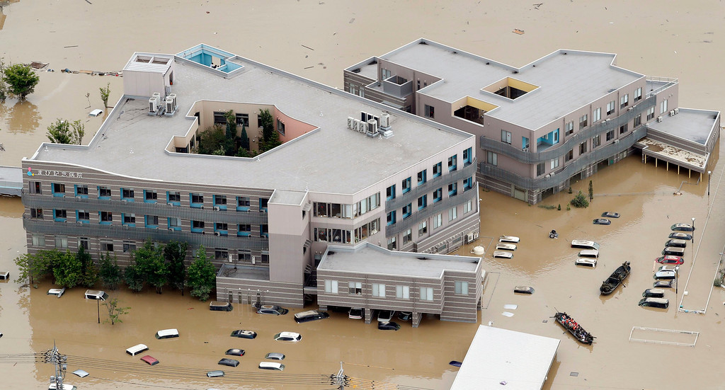 . A hospital is flooded by muddy water following heavy rain in Kurashiki city, Okayama prefecture, southwestern Japan, Sunday, July 8, 2018. Heavy rainfall hammered southern Japan for the third day, prompting new disaster warnings on Kyushu and Shikoku islands on Sunday. (Shohei Miyano/Kyodo News via AP)