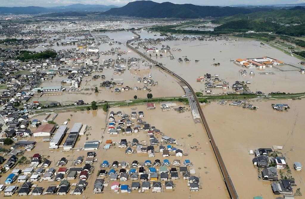 . Houses are partly submerged in water, following heavy rain in Kurashiki city, Okayama prefecture, southwestern Japan, Sunday, July 8, 2018. Heavy rainfall hammered southern Japan for the third day, prompting new disaster warnings on Kyushu and Shikoku islands Sunday. (Shohei Miyano/Kyodo News via AP)