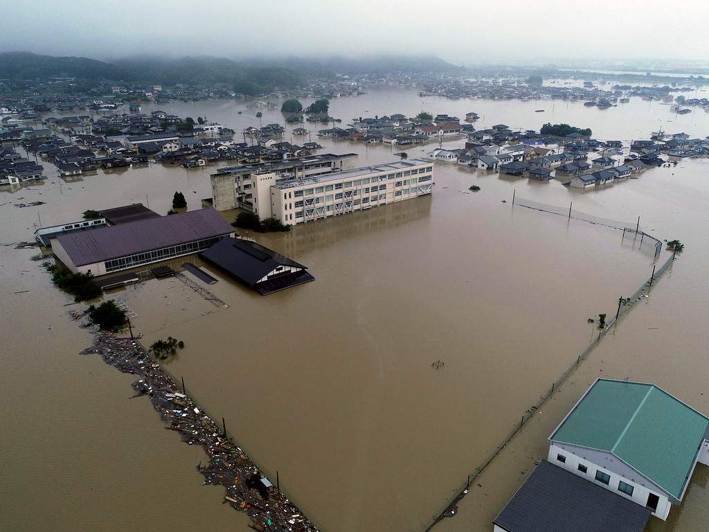 . The compound of a junior high school is flooded after heavy rains in Kurashiki, Okayama prefecture, southwestern Japan, Saturday, July 7, 2018. Heavy rainfall hammered southern Japan for the third day, prompting new disaster warnings on Kyushu and Shikoku islands Sunday. (Koji Harada/Kyodo News via AP)