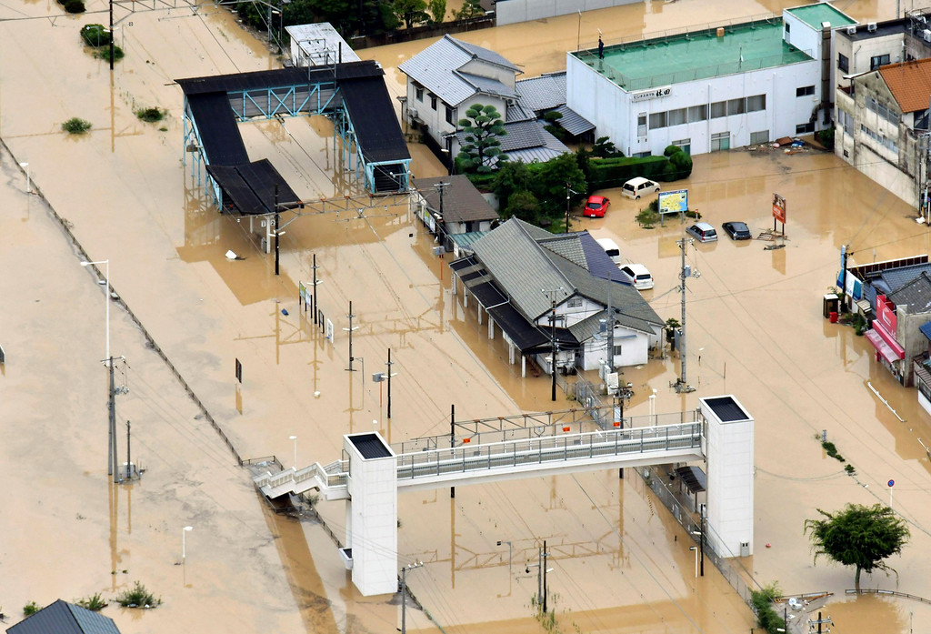 . Buildings are partially submerged by floodwaters caused by heavy rains in Kure, south western Japan, Saturday, July 7, 2018. Torrents of rainfall and flooding continued to batter southwestern Japan. (Shingo Nishizume/Kyodo News via AP)