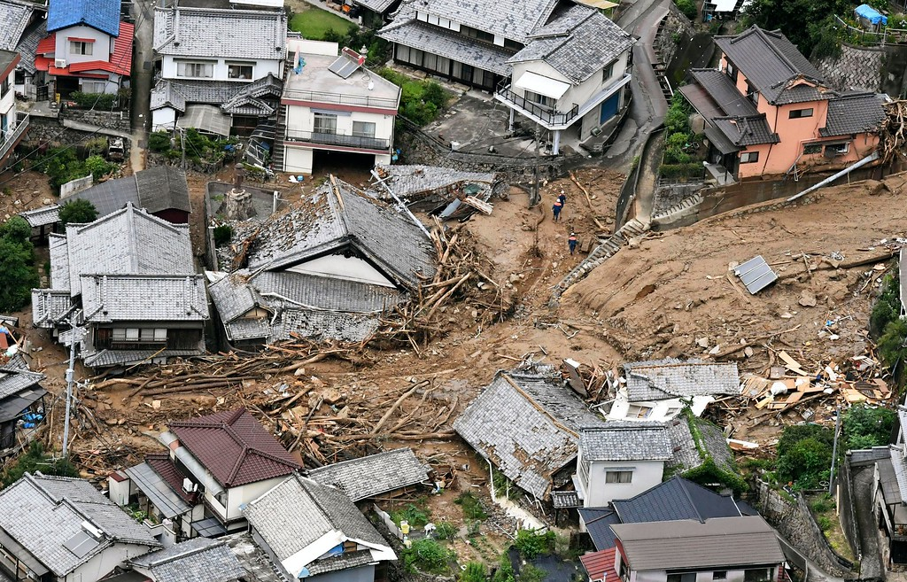 . Houses are damaged by mudslide following heavy rains in Kure city, Hiroshima prefecture, southwestern Japan, Saturday, July 7, 2018. Heavy rainfall hammered southern Japan for the third day, prompting new disaster warnings on Kyushu and Shikoku islands Sunday. (Koji Harada/Kyodo News via AP)