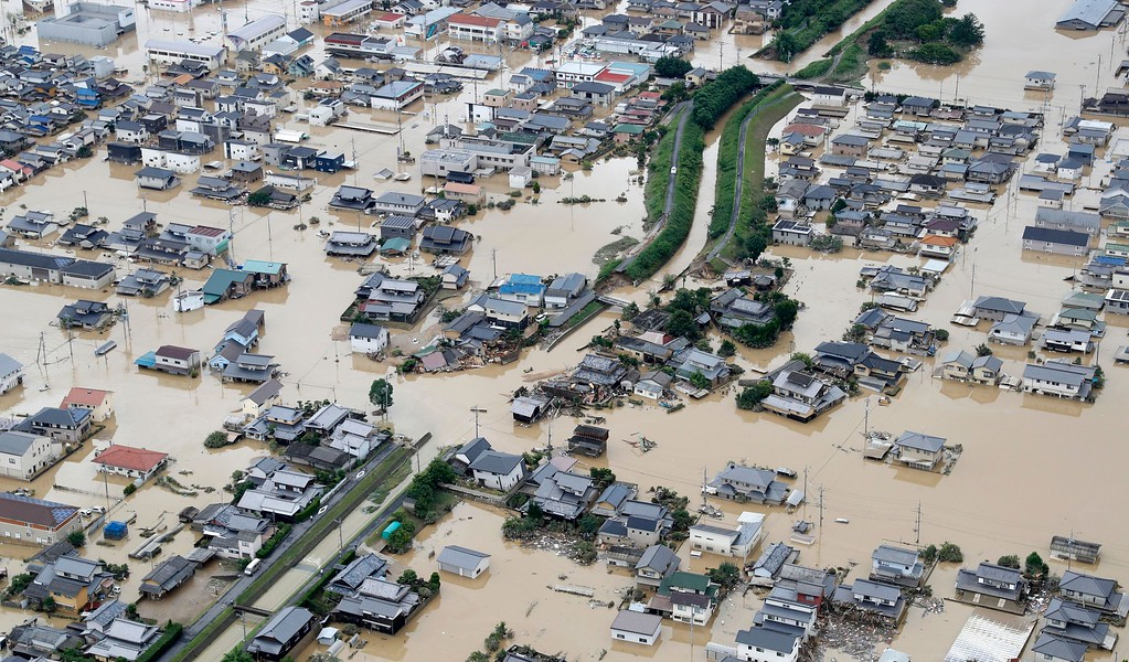 . Houses are submerged by muddy water following heavy rain in Kurashiki city, Okayama prefecture, southwestern Japan, Sunday, July 8, 2018. Heavy rainfall hammered southern Japan for the third day, prompting new disaster warnings on Kyushu and Shikoku islands on Sunday. (Shohei Miyano/Kyodo News via AP)