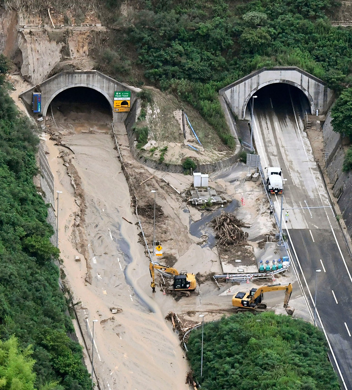 . A highway is covered with mud after heavy rains in Hiroshima, southwestern Japan, Saturday, July 7, 2018. Heavy rainfall hammered southern Japan for the third day, prompting new disaster warnings on Kyushu and Shikoku islands Sunday. (Kyodo News via AP)