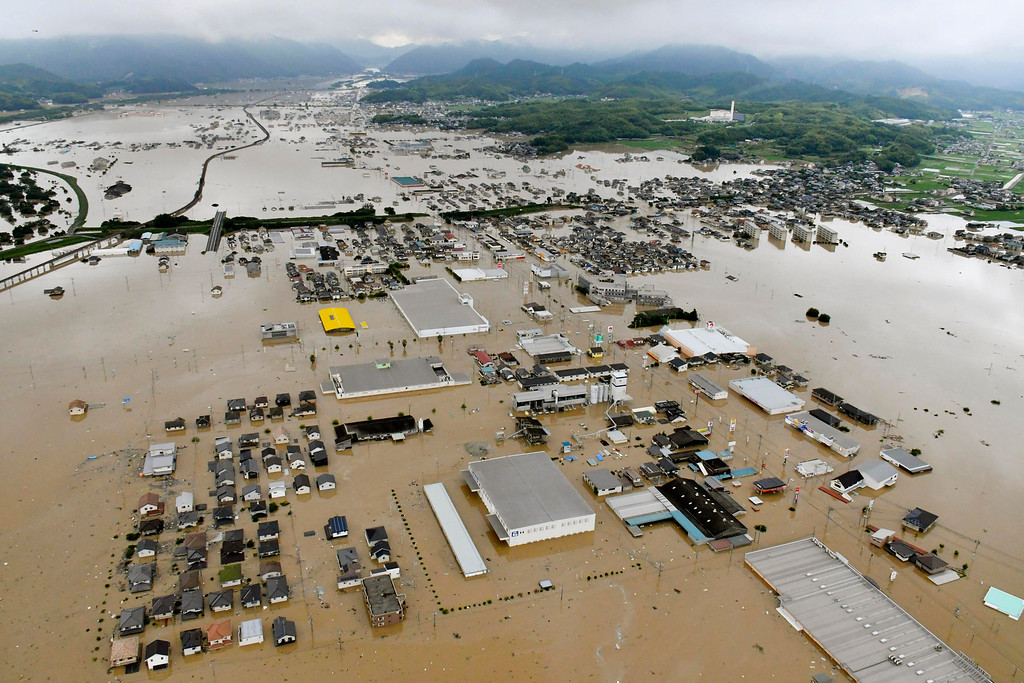 . Buildings are almost submerged in floodwaters caused by heavy rains in Kurashiki, Okayama prefecture, southwestern Japan, Saturday, July 7, 2018. Torrents of rainfall and flooding continued to batter southwestern Japan. (Shingo Nishizume/Kyodo News via AP)