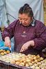 A street food vendor preparing traditional Japanese dishes in Askakusa, Tokyo, Japan.