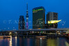 High rise office buildings and the Tokyo Skytree tower illuminated at night with the Sumida River in Asakusa, Tokyo, Japan.