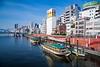 Reflections of boats in the Sumida River in Asakusa, Tokyo, Japan.