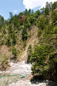 Rescue team descending from a helicopter at Kurobe Gorge