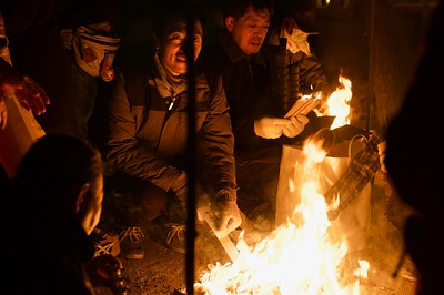 Locals bringing the embers home as good luck charm and to welcome the new year
