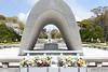 Hiroshima victims memorial cenotaph, Peace Memorial Park, Hiroshima, Mon 1 April 2019.  Looking towards the Atomic Bomb Dome.