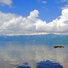 White clouds and blue sky reflections