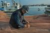 Repairing a fishing net, Naruto Harbour, Shikoku Island, Japan