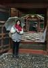 Woman-with-a-red-scarf,-Tosho-gu-Shinto-Shrine,-Shizuoka,-Japan