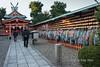 Wooden-prayer-cards-and-paper-cranes-for-sale-at-Fushima-Inari-Shinto-shrine,-Kyoto,-Japan