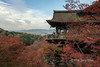 Kiyomizudera Honden (Great Hall) looking towards Kyoto city with fall colours, Kyoto, Japan