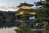 Kinkaku-ji-(Golden-Pavilion)-from-the-side-with-cypress-trees,-Rokuonji,-Kyoto,-Japan