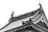 Matsumoto Castle, detail of eaves with pigeons, BW, Nagano, Japan