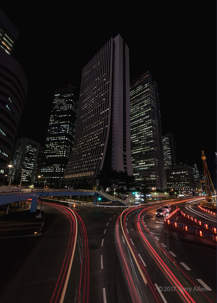 Shinjuku traffic and skyscrapers at night, Tokyo, Japan