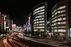 Night scene by Shinjuku Station, Tokyo, Japan