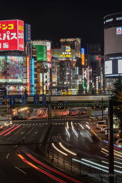 Speeding train with Shinjuku night lights, Tokyo, Japan