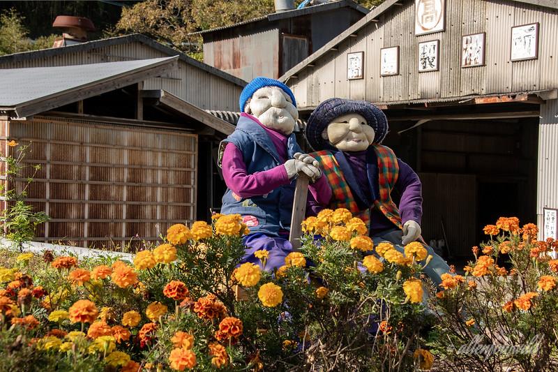 Kakashi doll couple with flowers, Kamiyama, Tokushima, Shikoku Island, Japan