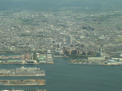 Osaka from the air.... This particular airport is built on a man made island just off of the mainland. You can see examples of these islands from the air on the approach.
