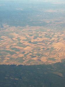 Neat patterns from the air! You can certainly see what irrigated and what is not. I think this was around the idaho or wyoming area in a valley in between the mountains.