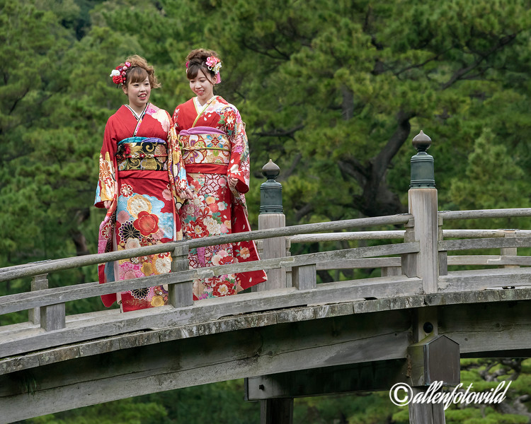 Similing sisters in beautiful kimono on the Geishun-kyo Bridge, Ritsurin Garden, Takamatsu, Japan