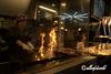 Cooking katsuo no tataki (seared bonito) over an open flame, Kochi, Japan