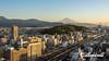 Cityscape at sunrise with Mt Fuji and railway lines with shinkansen, Shizuoka, Japan