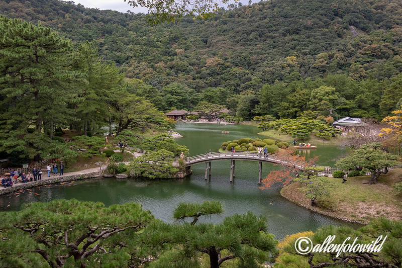 Geishun-kyo Bridge and Fuyoho Hill with koi feeding and boating, Ritsurin Garden, Takamatsu, Japan