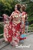 Two young women in beautiful traditional attire on the Geishun-kyo Bridge, Ritsurin Garden, Takamatsu, Japan