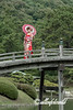 Young woman in kimono crossing the Geishun-kyo Bridge, Ritsurin Garden, Takamatsu, Japan