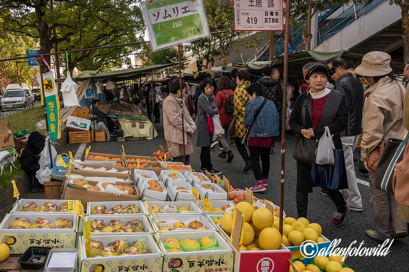 Fruit stand and crowds at the Sunday Market, Kochi, Japan
